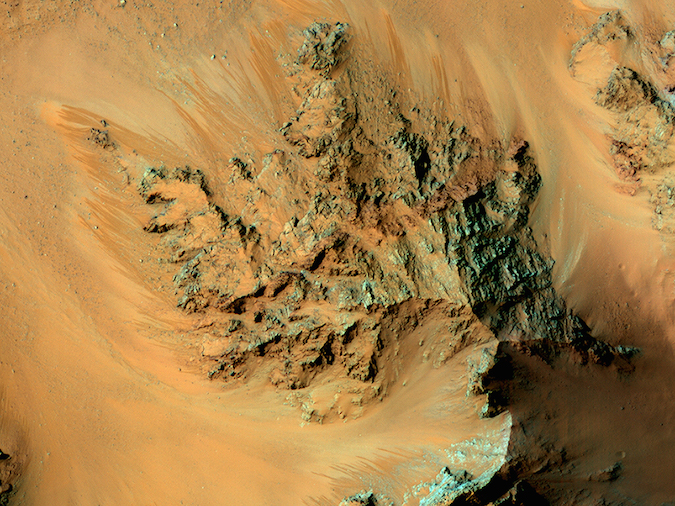 The Mars Reconnaissance Orbiter's HiRISE camera captured this view of seasonal water flows in the central mountains of Hale Crater. The recurring features appear as finger-like appendages emanating from the raised terrain in the center of the image. Credit: NASA/JPL/University of Arizona
