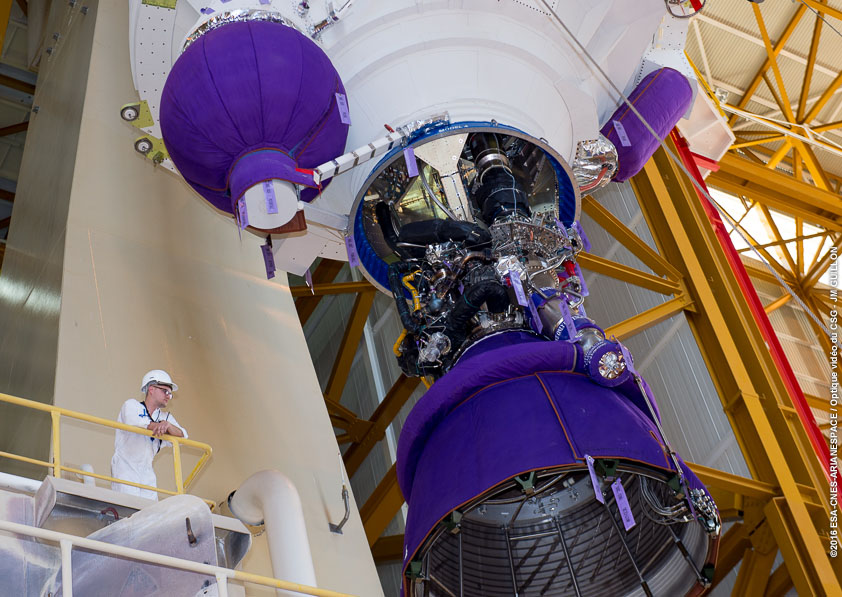 A technician inside the Ariane 5's launcher integration building gives a sense of scale to the rocket's first stage Vulcain 2 engine as the launch campaign began July 9 for next month's mission for Intelsat. Credit: ESA/CNES/Arianespace – Photo Optique Video du CSG – JM Guillon