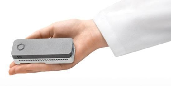 The MinION (aka Biomolecule Sequencer), a miniaturized DNA sequencer, is made by Oxford Nanopore Technologies. The palm-sized sequencer is powered via USB connection to a laptop or tablet and does not require a battery. Credit: Oxford Nanopore Technologies