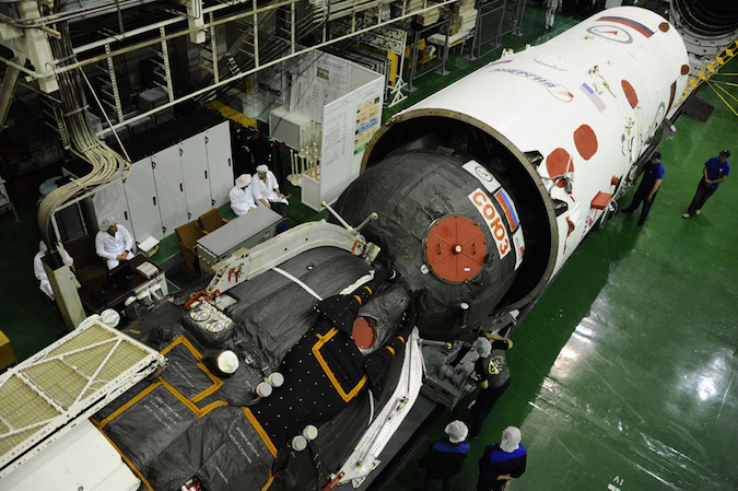 The Soyuz MS-01 spacecraft is installed inside a aerodynamic fairing for launch. Credit: Energia