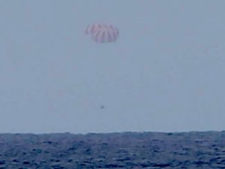 SpaceX released this view of the Dragon spacecraft descending to the Pacific Ocean on Friday. Credit: SpaceX