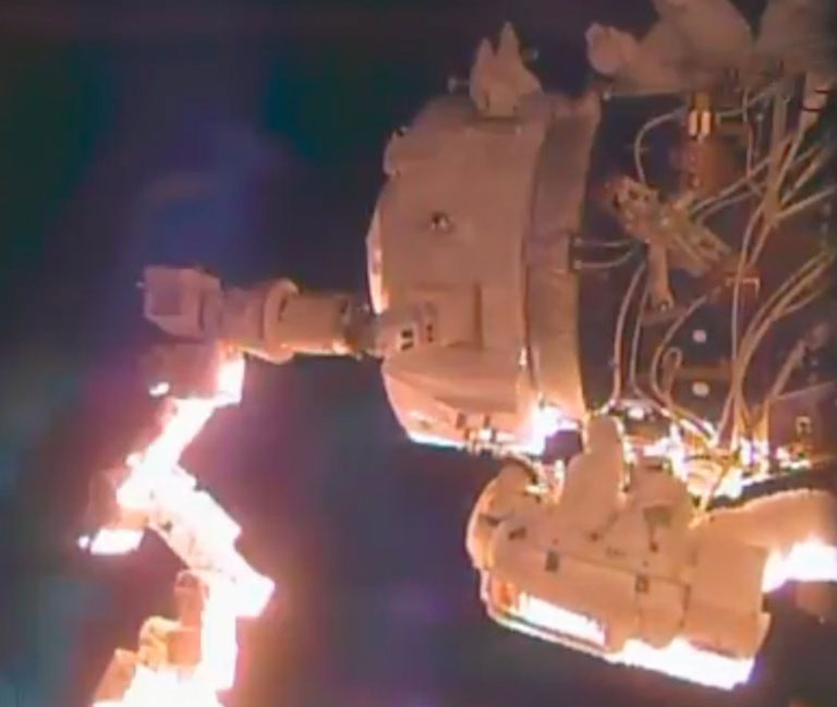 The International Docking Adapter, in position in front of PMA-2. Image: NASA TV/Spaceflight Now.