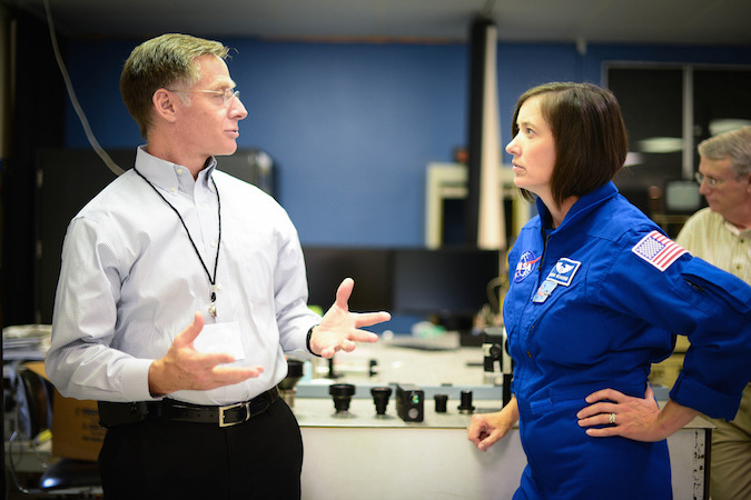 Chris Ferguson, director of CST-100 crew and mission operations, talks with NASA sstronaut Megan McArthur during a visit to Advanced Scientific Concepts in Santa Barbara, California, which is building 3D Flash Light Detection and Ranging sensors for Boeing's CST-100 Starliner spacecraft. Credit: Boeing