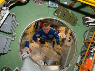 Russian cosmonaut Alexey Ovchinin is seen floating through the hatch way of the Russian segment aboard the International Space Station in July. Credit: NASA