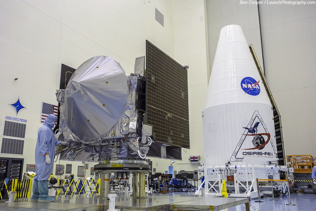 A member of the OSIRIS-REx team prepares the spacecraft for launch Sept. 8. The Atlas 5 rocket's payload fairing is in the background. Credit: Ben Cooper/Launchphotography.com