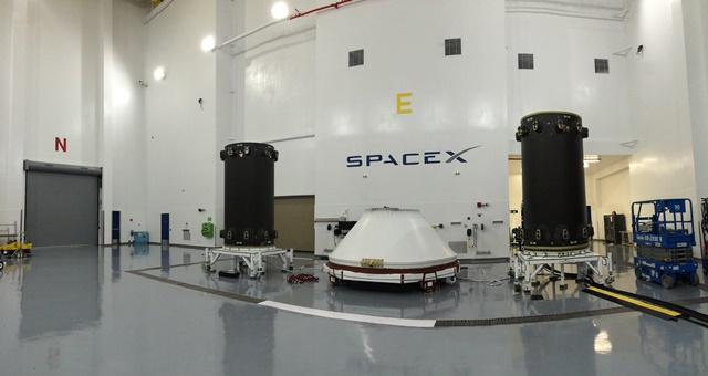Two parts of the first Iridium Next dispenser pictured inside SpaceX's processing facility at Vandenberg Air Force Base. The components arrived at Vandenberg in June. Credit: SpaceX