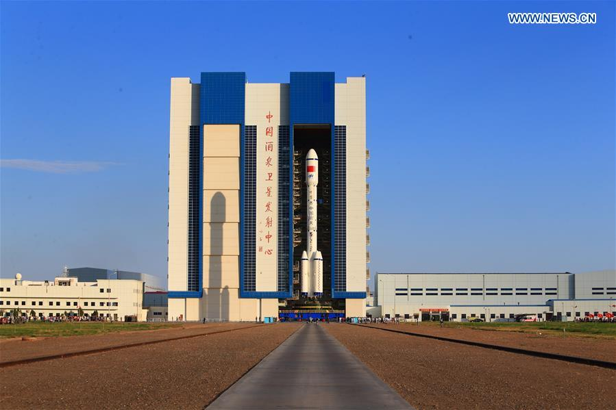The Long March 2F T2 rocket, topped with the Tiangong 2 space lab module, rolled out of its assembly building at Jiuquan on Sept. 8. Credit: Xinhua