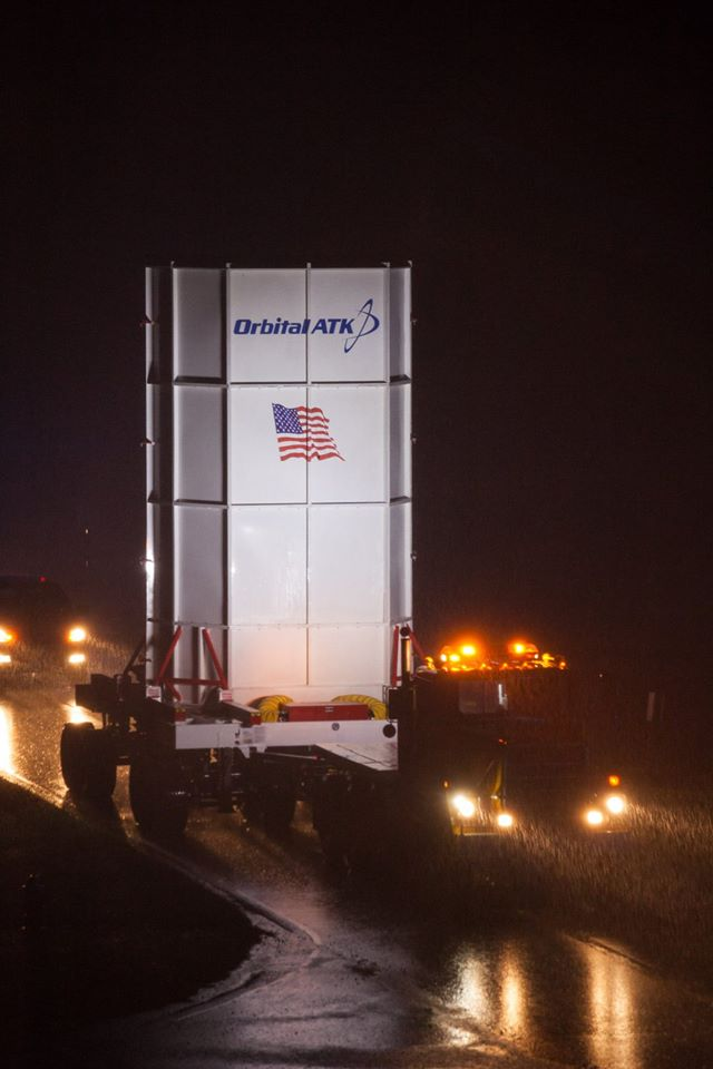 The Cygnus spacecraft, positioned inside a transporter, moved to a fueling facility Monday night at Wallops Island, Virginia. Credit: NASA/Allison Stancil