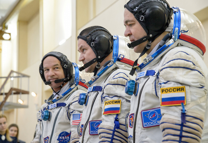 Jeff Williams, Alexei Ovchinin and Oleg Skripochka line up for final qualification exams in February before their launch to the International Space Station. Credit: NASA/Bill Ingalls
