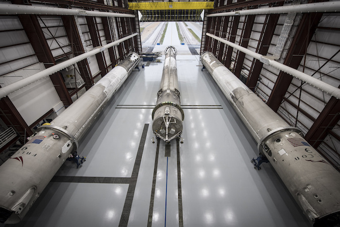 Three of SpaceX's recovered Falcon 9 boosters inside a hangar at launch pad 39A. Credit: SpaceX