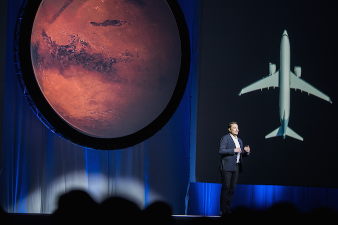 Elon Musk presents his Mars colonization vision at the International Astronautical Congress on Tuesday in Guadalajara, Mexico. Credit: Tim Dodd/Spaceflight Now/www.timdoddphotography.com