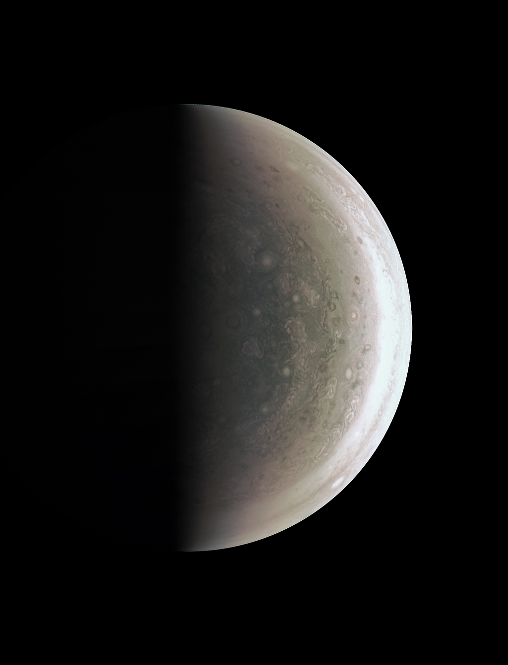 This image from NASA's Juno spacecraft provides a never-before-seen perspective on Jupiter's south pole. The JunoCam instrument acquired the view on August 27, 2016, when the spacecraft was about 58,700 miles (94,500 kilometers) above the polar region. At this point, the spacecraft was about an hour past its closest approach, and fine detail in the south polar region is clearly resolved. Unlike the equatorial region's familiar structure of belts and zones, the poles are mottled by clockwise and counterclockwise rotating storms of various sizes, similar to giant versions of terrestrial hurricanes. Credit: NASA/JPL-Caltech/SwRI/MSSS