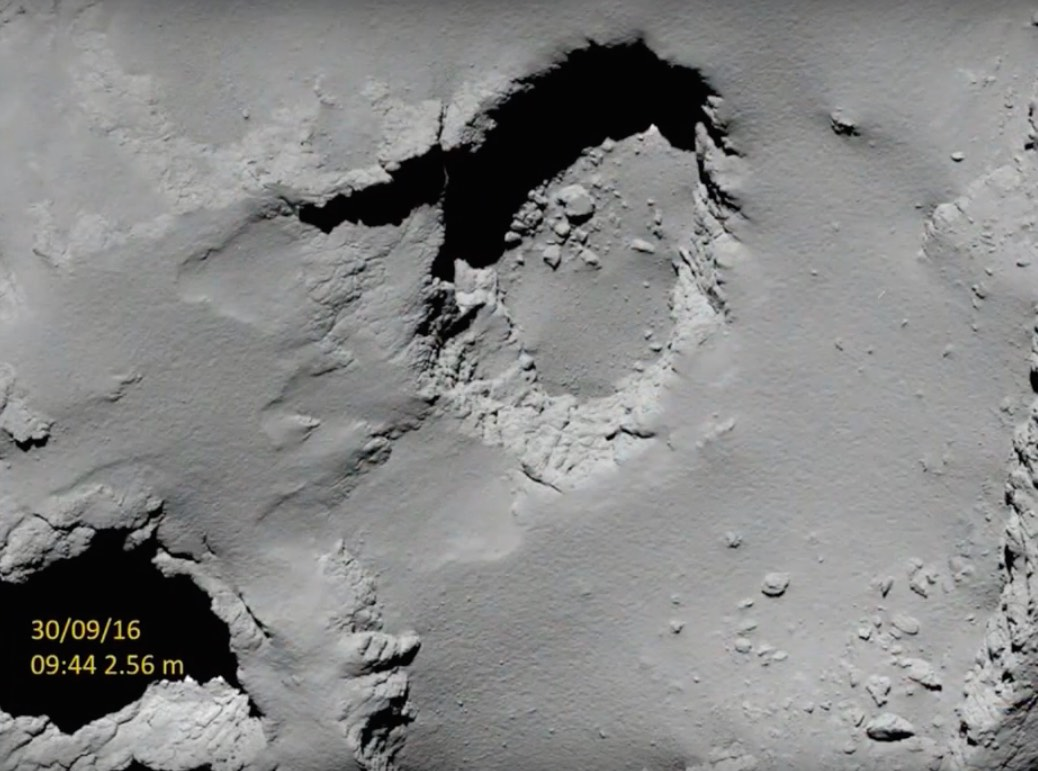 This view of the Deir el-Medina pit was captured by the OSIRIS wide-angle camera about 55 minutes before landing. Credit: ESA/Rosetta/MPS for OSIRIS Team MPS/UPD/LAM/IAA/SSO/INTA/UPM/DASP/IDA
