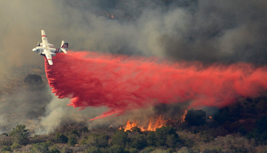A CalFire S-2T makes a Phos-Chek drop on the Vandenberg fire. Credit: Santa Barbara County Fire Dept.