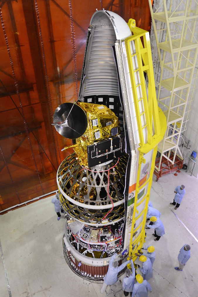 The ScatSat 1 satellite, pictured at the top, launched with seven other satellites wrapped inside the dual-payload launch adapter. This image was taken before the payloads were encapsulated inside the PSLV's nose fairing. Credit: ISRO