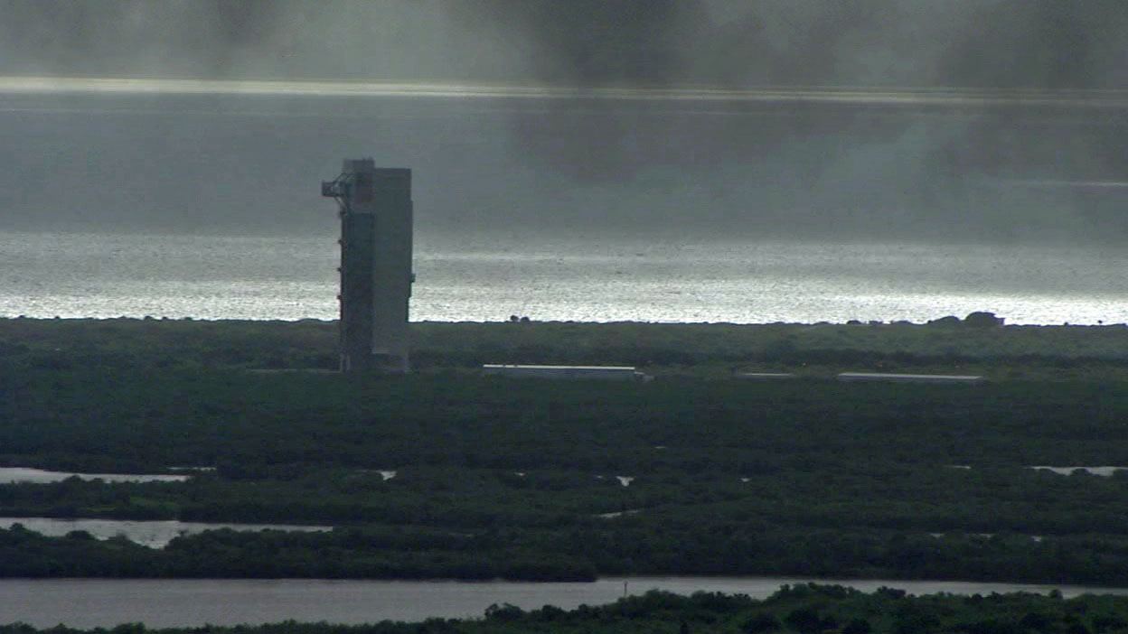 Black smoke hangs in the air at the Atlas 5 rocket's assembly building Thursday morning.