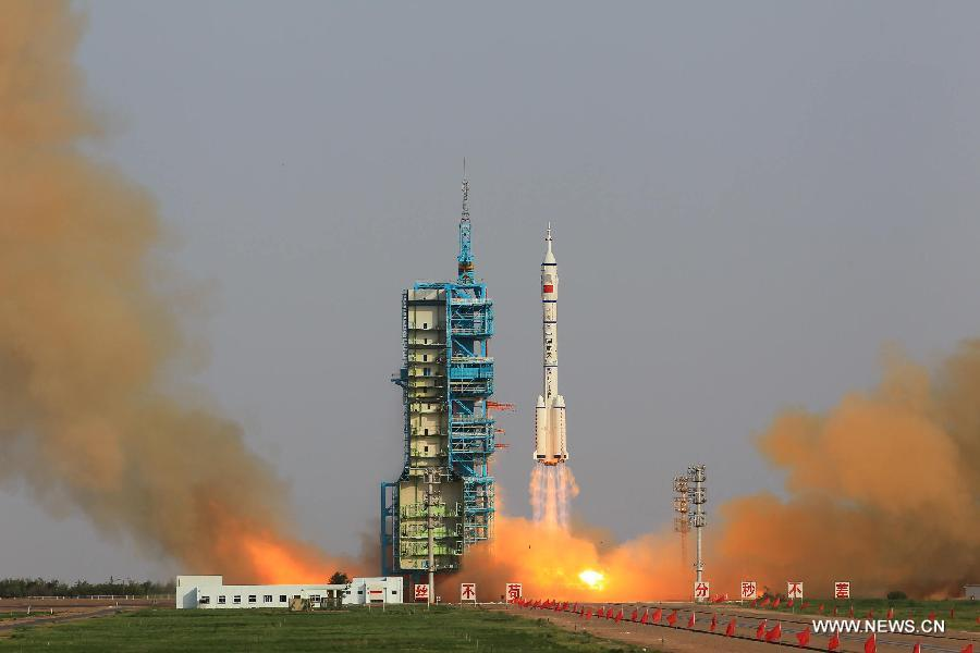The 191-foot-tall (58-meter) Long March 2F rocket lifts off from the Jiuquan satellite launching center.