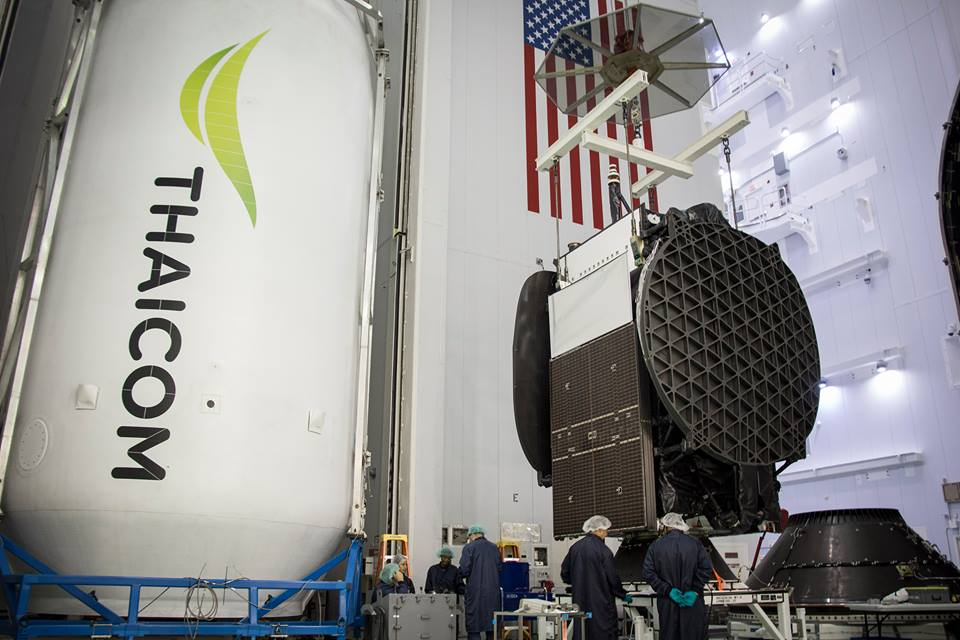 File photo of the Thaicom 8 satellite being prepared for launch inside SpaceX's payload processing facility. Credit: SpaceX