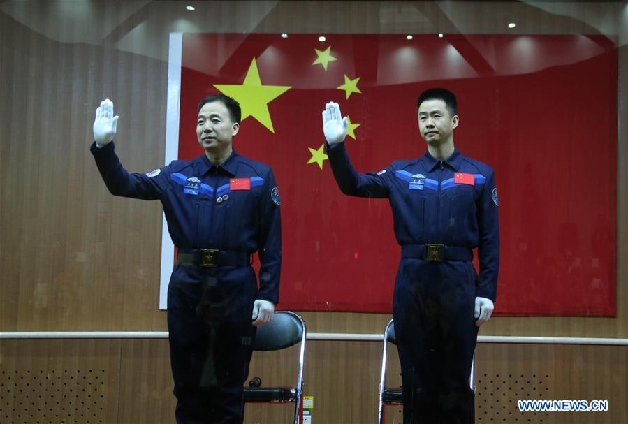 Astronauts Jing Haipeng (left) and Chen Dong (right) will fly in space for 33 days aboard Shenzhou 11. They were introduced to the media early Sunday. Credit: Xinhua