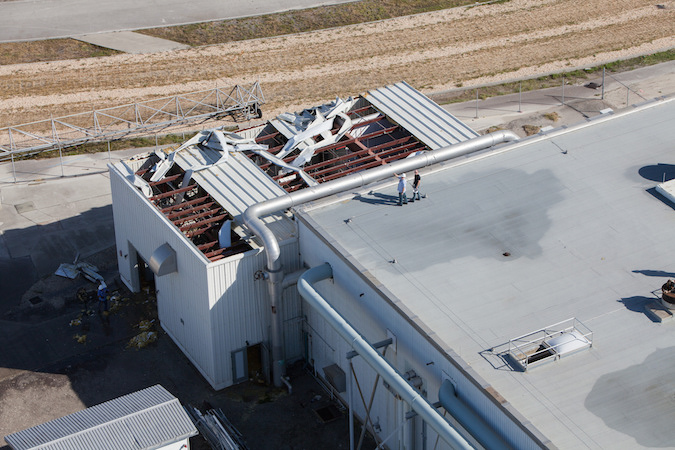 The roof of this utility support building collapsed during Hurricane Matthew. Credit: NASA/Cory Huston