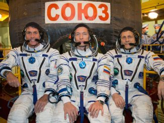 NASA astronaut Shane Kimbrough, Soyuz commander Sergey Ryzhikov and flight engineer Andrey Borisenko pose for a picture in their Sokol launch and entry spacesuits outside the Soyuz MS-02 spaceship. Credit: NASA/Victor Zelentsov