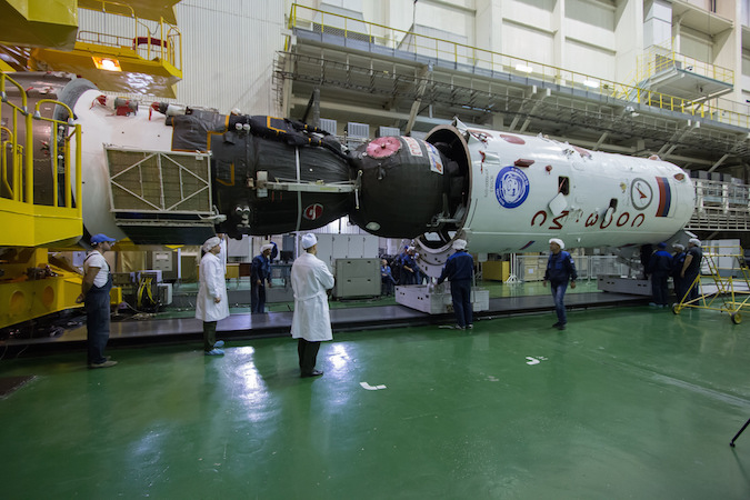 The Soyuz MS-02 spacecraft is seen installed into the Soyuz rocket's fairing. Credit: NASA/Victor Zelentsov