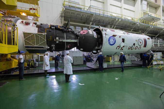 The Soyuz MS-02 spacecraft is seen installed into the Soyuz rocket's fairing. Credit: NASA/Victor Zelentsov