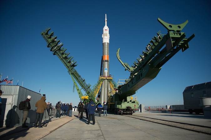 The Soyuz rocket ready to launch the next three-man crew to the International Space Station stands on its launch pad in Kazakhstan after rollout Sunday. Credit: NASA/Joel Kowsky