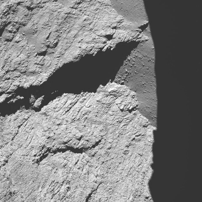 Rosetta's OSIRIS narrow-angle camera recorded this view of comet 67P/Churyumov-Gerasimenko from a distance of 7.3 miles (11.7 kilometers) at 0525 GMT (1:25 a.m. EDT) on Sept. 30. The field-of-view stretches nearly 1,500 feet (450 meters) across, and the resolution is about 8.7 inches (22 centimeters) per pixel. Credit: ESA/Rosetta/MPS for OSIRIS Team MPS/UPD/LAM/IAA/SSO/INTA/UPM/DASP/IDA