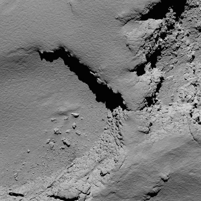 Rosetta's OSIRIS narrow-angle camera captured this image of comet 67P/Churyumov-Gerasimenko from a distance of 3.6 miles (5.8 kilometers) at 0818 GMT (4:18 a.m. EDT) on Sept. 30. The field-of-view stretches about 740 feet (225 meters) across, and the resolution is about 4.3 inches (11 centimeters) per pixel. Credit: ESA/Rosetta/MPS for OSIRIS Team MPS/UPD/LAM/IAA/SSO/INTA/UPM/DASP/IDA