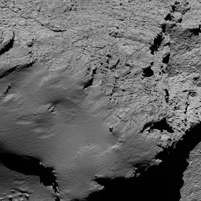 Rosetta's OSIRIS narrow-angle camera captured this view of comet 67P/Churyumov-Gerasimenko from a distance of 5.5 miles (8.9 kilometers) at 0653 GMT (2:53 a.m. EDT) no Sept. 30. The field-of-view stretches nearly 1,150 feet (350 meters) across, and the resolution is 6.7 inches (17 centimeters) per pixel. Credit: Credit: ESA/Rosetta/MPS for OSIRIS Team MPS/UPD/LAM/IAA/SSO/INTA/UPM/DASP/IDA