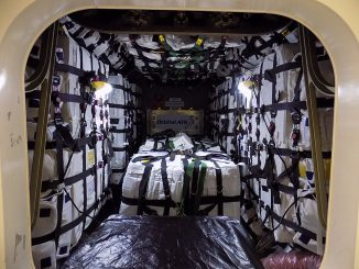 A view inside the pressurized cargo module of Orbital ATK's Cygnus spacecraft after technicians loaded the final supplies heading for the International Space Station. Credit: Orbital ATK