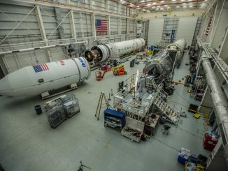 A view of the Antares rocket (left) undergoing final preparations for the upcoming launch. Credit: Orbital ATK