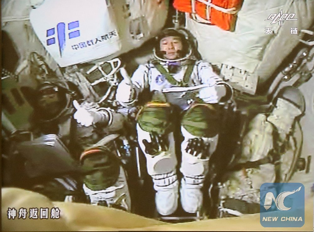 Astronauts Chen Dong (left) and Jing Haipeng (right) inside the Shenzhou 11 spacecraft for docking with Tiangong 2. Credit: Xinhua