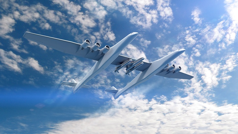 An artist's concept of Stratolaunch's carrier aircraft with three Pegasus rockets. Credit: Stratolaunch Systems