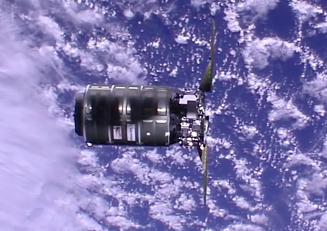 The Cygnus supply ship, measuring about 21 feet (6 meters) long, on final approach to the space station Sunday. Credit: NASA TV/Spaceflight Now