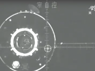 The Tiangong 2 space lab is pictured in this video frame from a camera aboard Shenzhou 11. The two spacecraft linked up on a night pass in orbit. Credit: CCTV