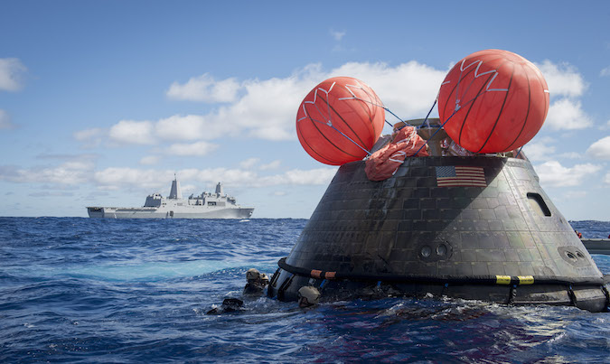 An Orion spacecraft awaits recovery by U.S. Navy personnel after a successful unpiloted orbital test flight in December 2014. Credit: U.S. Navy photo by Mass Communication Specialist 1st Class Gary Keen.