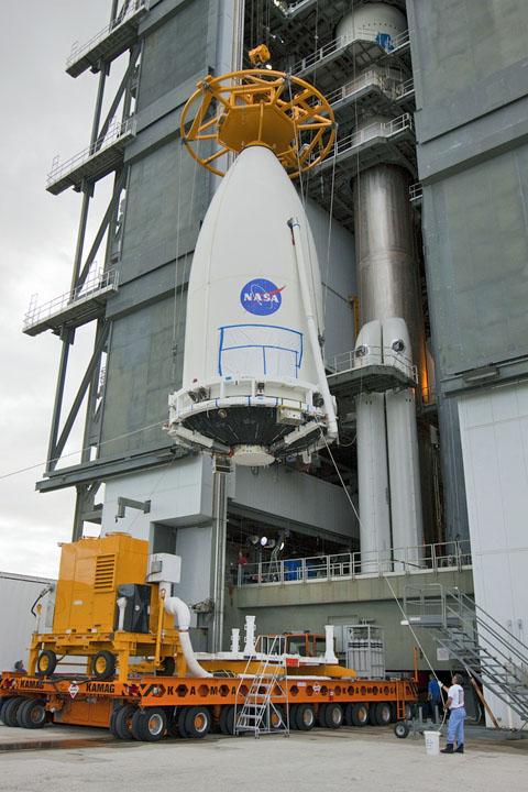 File photo of satellite in Atlas 5 rocket payload in 5-meter fairing being hoisted. Credit NASA-KSC