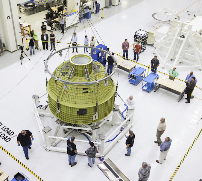 The pressure shell for the Orion crew module set to launch on its next test flight in 2018 is undergoing flight preparations at the Kennedy Space Center in Florida. Credit: NASA/Ben Smegelsky