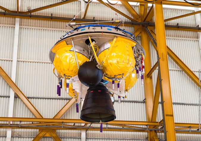 The storable propellant upper stage, known by the French acronym ESC, is seen during prelaunch processing inside the launcher integration building in French Guiana. Credit: ESA/CNES/Arianespace – Photo Optique Video du CSG – J. Durrenberger