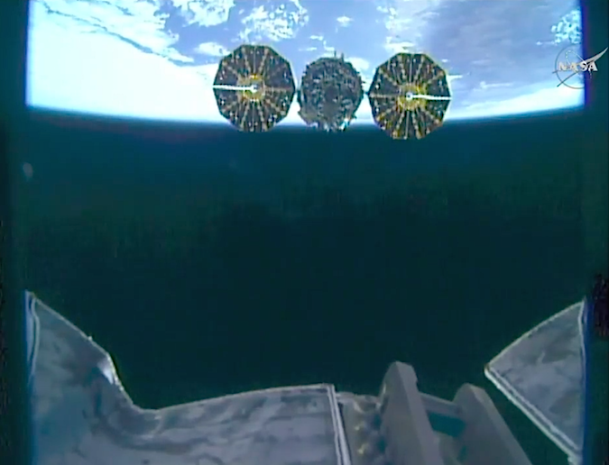 This view from the robot arm's end effector shows the Cygnus spacecraft departing the space station Monday. Credit: NASA TV/Spaceflight Now