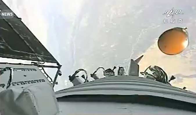The Shenzhou 11 landing capsule is seen separating from the spacecraft's propulsion module in this on-board camera view. Credit: CCTV