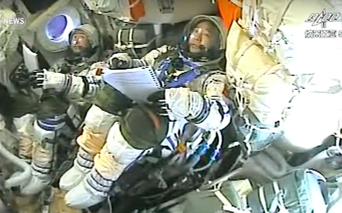 The Shenzhou 11 astronauts, Chen Dong (left) and Jing Haipeng (right), inside the spacecraft during Friday's descent. Credit: CCTV