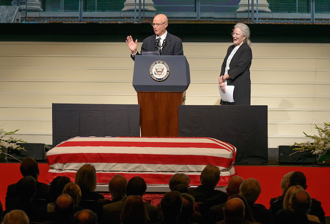 Son of former astronaut and U.S. Senator John Glenn, David Glenn, speaks about his father, as his sister Lyn looks on during a memorial service Saturday. Credit: NASA/Bill Ingalls