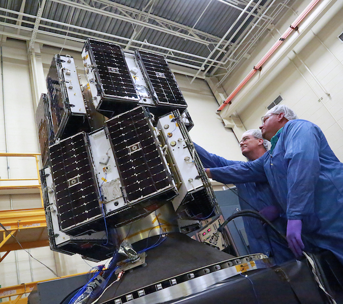 The eight CYGNSS microsatellites are pictured in launch configuration mounted to an adapter module provided by Sierra Nevada Corp. Credit: SWRI