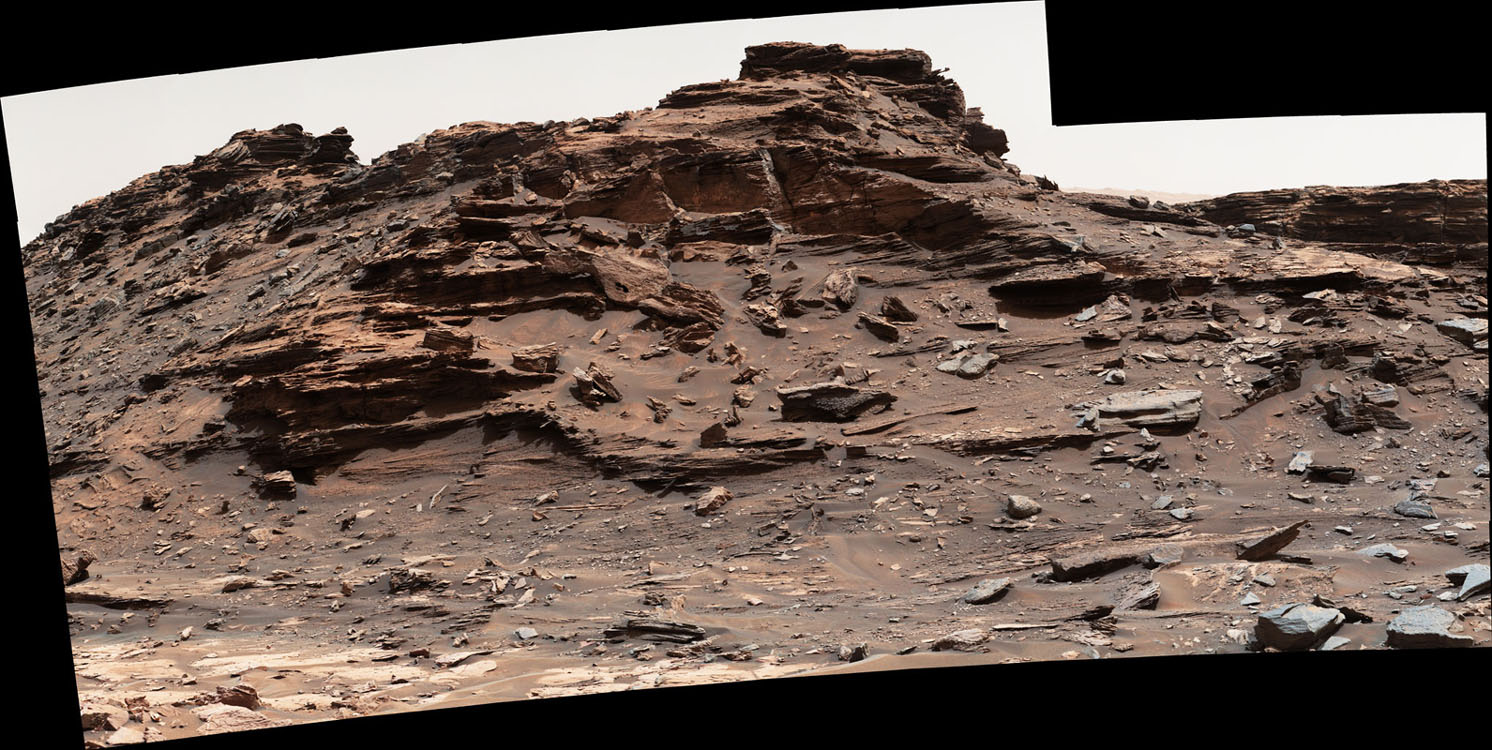 "The mast camera on the Curiosity rover captured this view of a butte standing about 16 feet (5 meters) above the vehicle Sept. 1, 2016, while the spacecraft was driving through the scenic ""Murray Buttes"" region on Mars. Credit: NASA/JPL-Caltech/MSSS"
