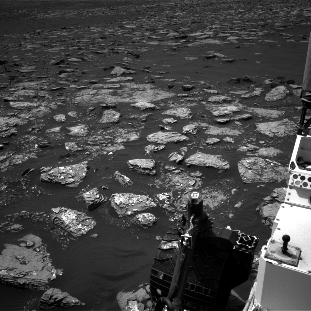 "This view from the Navigation Camera on the mast of NASA's Curiosity Mars rover taken Dec. 2, 2016, shows rocky ground within view while the rover was working at an intended drilling site called ""Precipice"" on lower Mount Sharp. Credit: NASA/JPL-Caltech"