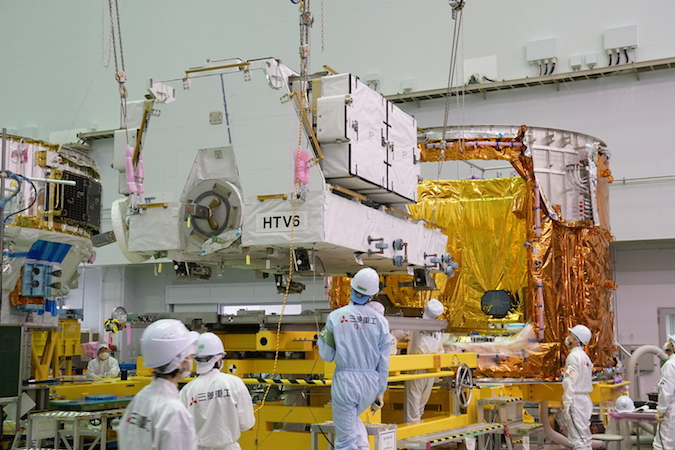 The HTV ground team installs the cargo pallet holding the space station's six new lithium-batteries inside the supply ship before launch. Credit: JAXA