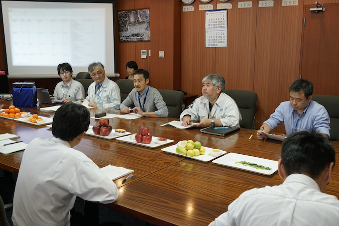 JAXA officials meet to select fresh fruit to be delivered to the space station crew aboard Kounotori 6. Credit: JAXA